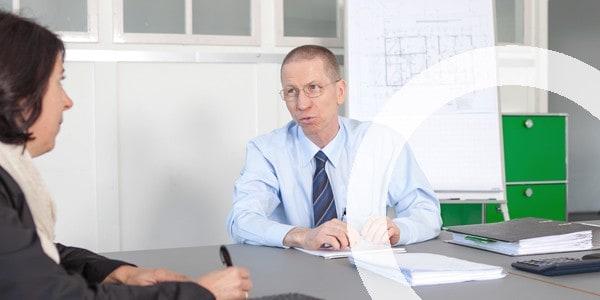 Wolfer UTS GmbH | Gespräch mit Kunden für Geschäftsbesorgungen Bau- und Immobilienbranche